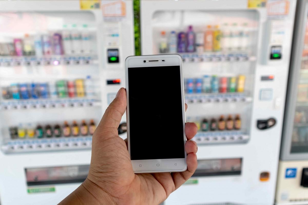 utilisation smartphone paiement distributeur
